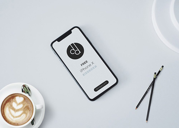 iPhone X on Table Free Mockup PSD