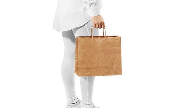 Free Woman Carrying Paper Bag Mockup