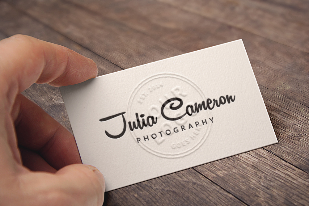 Embossed Business Card in Hand - Free PSD Mockup