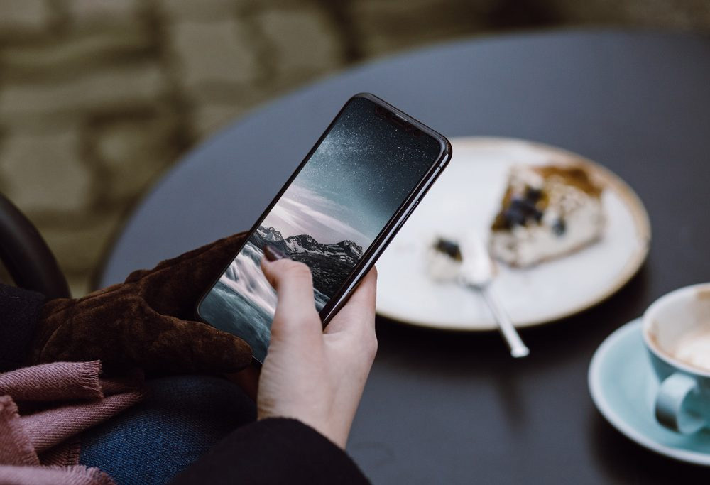 Woman at Cafe iPhone X - Free Mockup