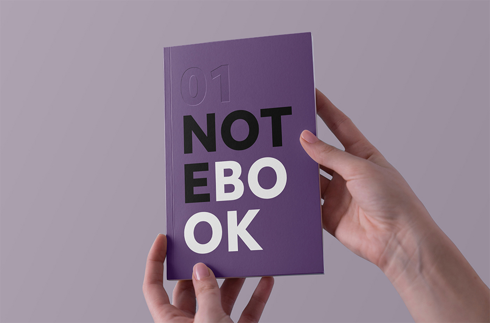 Notebook in Hand - Free Mockup